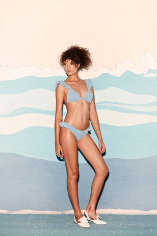 CLUBE BOSSA Laven Ruffle Triangle Bikini Top - Riviera Blue Bikini Top | Riviera Blue| Clube Bossa Laven Ruffle Triangle Bikini Top - Riviera Blue. Features:  Blue triangle top Ruffle shoulder straps Textured fabric Front View