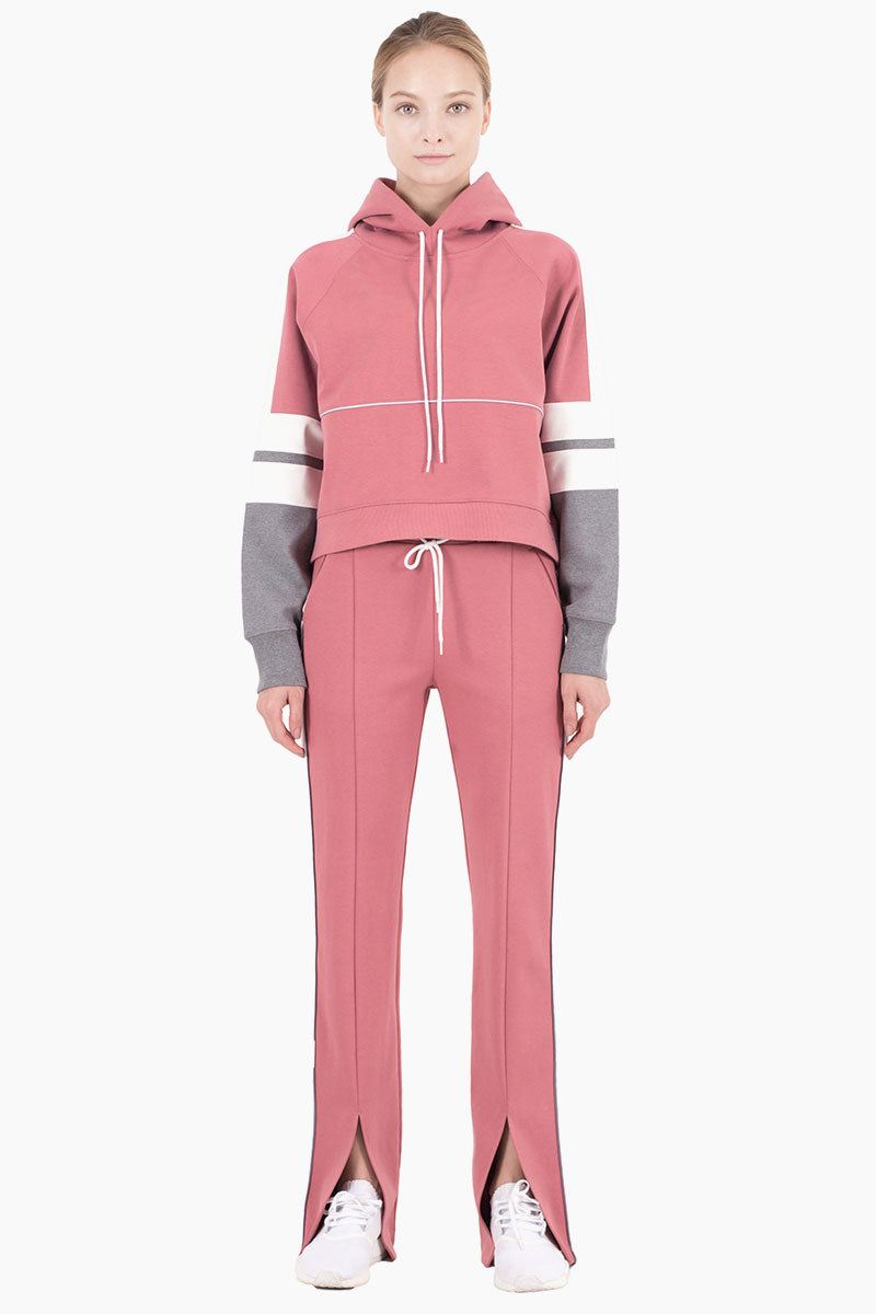 NYLORA Carson Hooded Color Block Drawstring Sweatshirt - Dusty Pink Top | Dusty Pink Combo| Nylora Carson Hoodie - Dusty Pink Combo. Features:   Hooded long sleeve sweatshirt  Drawstring detail  Color block sleeves  100% cotton  Front View