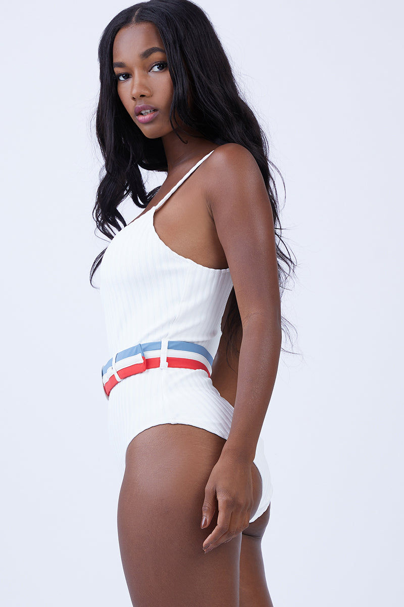 SOLID & STRIPED The Nina Belted One Piece Swimsuit - Cream Rib One Piece | Cream Rib| Solid & Striped The Nina Belted One Piece Swimsuit - Cream Rib Elegant one-piece with ribbed material Classic scoop neckline Spaghetti straps Waist defining belt  Fabric: 80% polyamide, 20% elastane Lining: 85% polyamide, 15% elastane Care Instructions: hand wash in cold water; do not tumble dry Side View