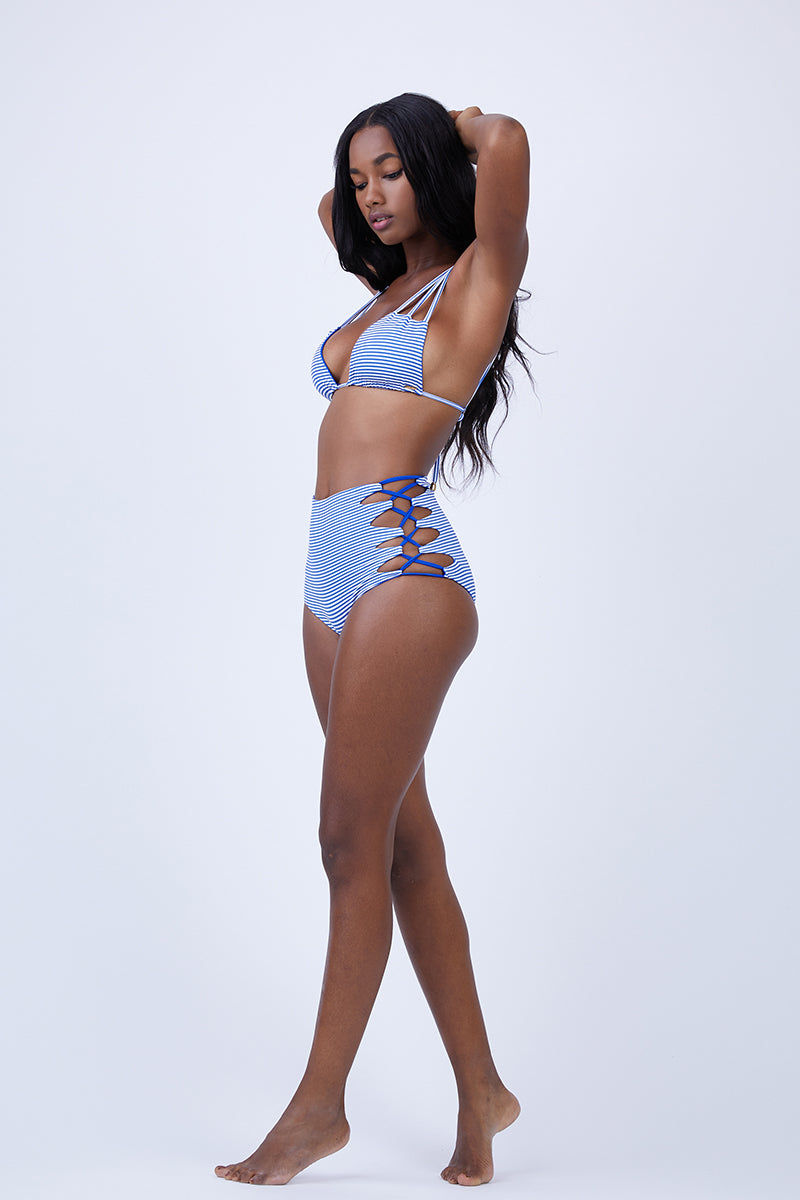 MAYLANA Dayja Reversible High Waisted Bikini Bottom - Blue Stripes/Blue Bikini Bottom | Blue Stripes/Blue| Maylana Dayja Reversible High Waisted Bikini Bottom - Blue Stripes/Blue High waisted bottom Caged detail at sides Full coverage at the rear Item features striped design Reversible to blue Flatlay View