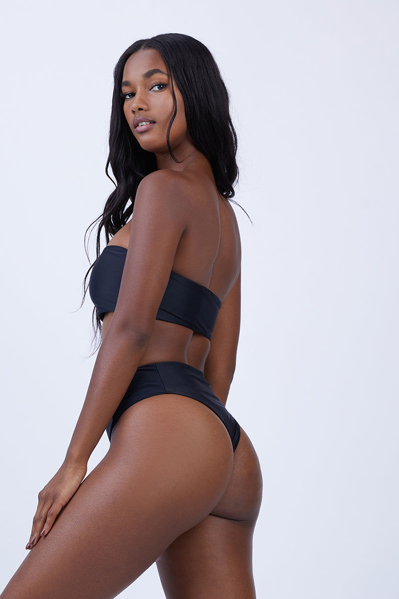 ABYSSE Benson High Waist Bikini Bottom - Black Bikini Bottom | Black| Abysse Benson High Waist Bikini Bottom - Black Features:  High waisted Bikini Bottom Side panel feature Cheeky Bum Dry Fast and UV protective Made in California out of 100% Italian Recycled Fabric (given new life through recycling ghost-fishing nets that pollute and kill their environment) Front View