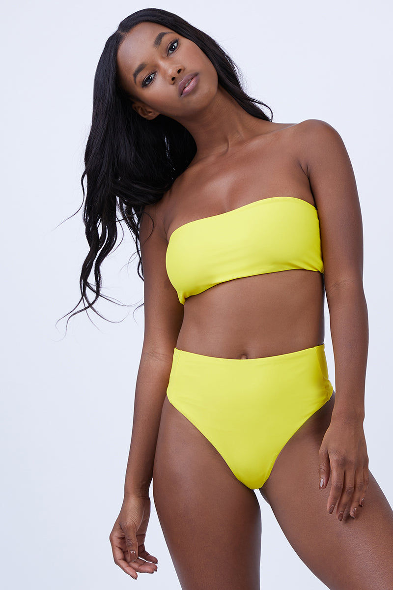 ABYSSE Benson High Waist Bikini Bottom - Yellow Bikini Bottom | Yellow | Abysse Benson High Waist Bikini Bottom - Yellow Features:  High waisted Bikini Bottom Side panel feature Cheeky Bum Dry Fast and UV protective Made in California out of 100% Italian Recycled Fabric (given new life through recycling ghost-fishing nets that pollute and kill their environment) Front View
