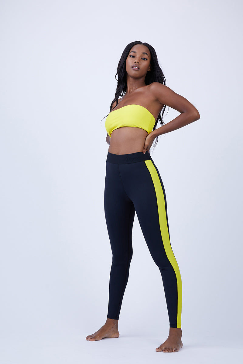 ABYSSE Junko Side Panel Leggings - Yellow Leggings | Yellow| Abysse Junko Side Panel Leggings – Yellow. Features:  Side Panel Feature Seamless: featuring ultrasonic welded seams Thermo welded pocket Aqua tech YKK zipper 2 inch elastic waistband Dry Fast and UV protective Muscle Compression fabric Front View