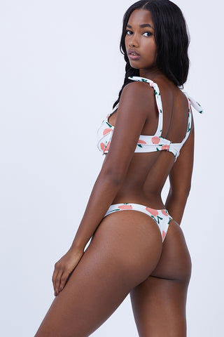 KAOHS Bella Thong Bikini Bottom - Peach Bikini Bottom | Peach| Kaohs Bella Thong Bikini Bottom - Peach Features:  Low rise bikini bottom High cut leg Wide waistband provides support for worry-free swimming Brazilian rear coverage Seamless fabric Front View