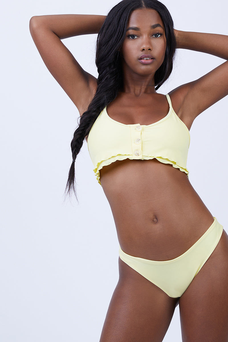 KAOHS Jimi Cheeky Bikini Bottom - Yellow Bikini Bottom | Yellow| Kaohs Jimi Cheeky Bikini Bottom - Yellow Features:  Modest coverage bottom Simple, clean and seamless 80% nylon/ 20% spandex Made in Los Angeles, California Wash in cold, dry in shade Front View