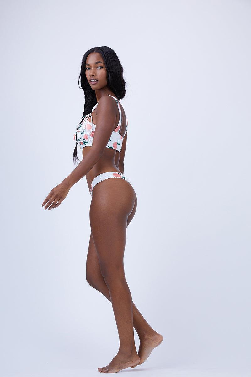 KAOHS Maddy Ruffle Bikini Bottom - Peach Bikini Bottom | Peach| Kaohs Maddy Ruffle Bikini Bottom - Peach Features:  Skimpy bikini bottom Seamless 80% nylon / 20% spandex Made in Los Angeles, California Flatlay View