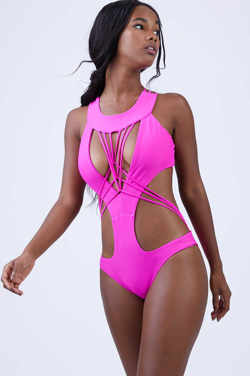 KEVA J Akila Cut Out One Piece Swimsuit - Fuschia One Piece | Fuschia| Keva J Akila Cut Out One Piece Swimsuit - Fuschia. Features:  Low cut one piece String detail at the bust and waist String detail that crosses in back for extra support Fits any bust size Double Lined Moderate coverage in the back 80% Nylon, 20% Spandex Made In The USA Front View