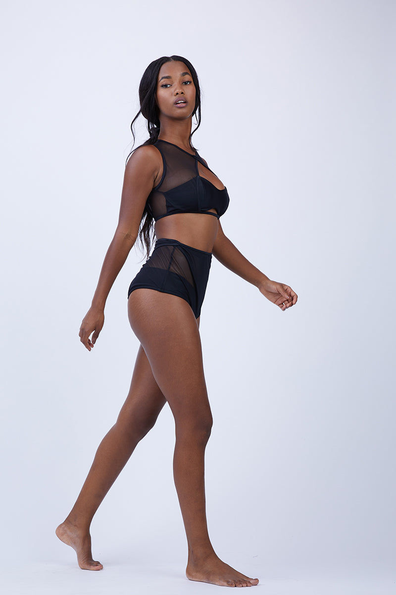 KEVA J Caiman High Waist Mesh Bikini Bottom - Black Bikini Bottom | Black| Keva J Caiman High Waist Mesh Bikini Bottom - Black. Features:  High waisted bikini bottom Pee-a-boo detail at front and back Moderate coverage 80% Nylon, 20% Spandex Double Lined Made In The USA Front View