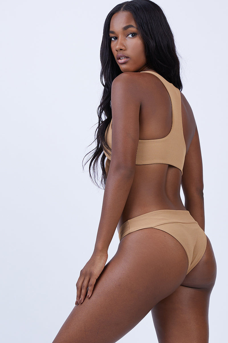 L SPACE Tara Front Bow Tie Bikini Top - Camel Bikini Top |  Camel| L Space Tara Front Bow Tie Bikini Top - Camel. Features: Pullover style Keyhole front Front bow detail Racerback Front