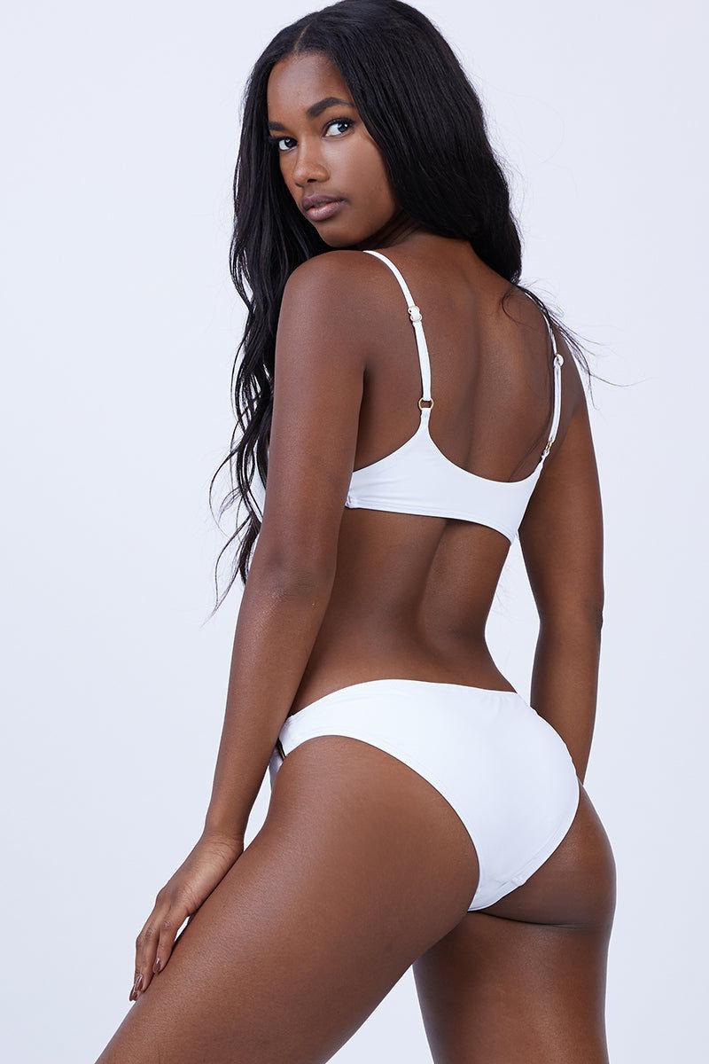 L SPACE Piper Bralette Bikini Top - White Bikini Top    White  L Space Paige Bralette Bikini Top - White. Features: •Bralette style top •Adjustable sliding straps •Gold hardware detail. Front View