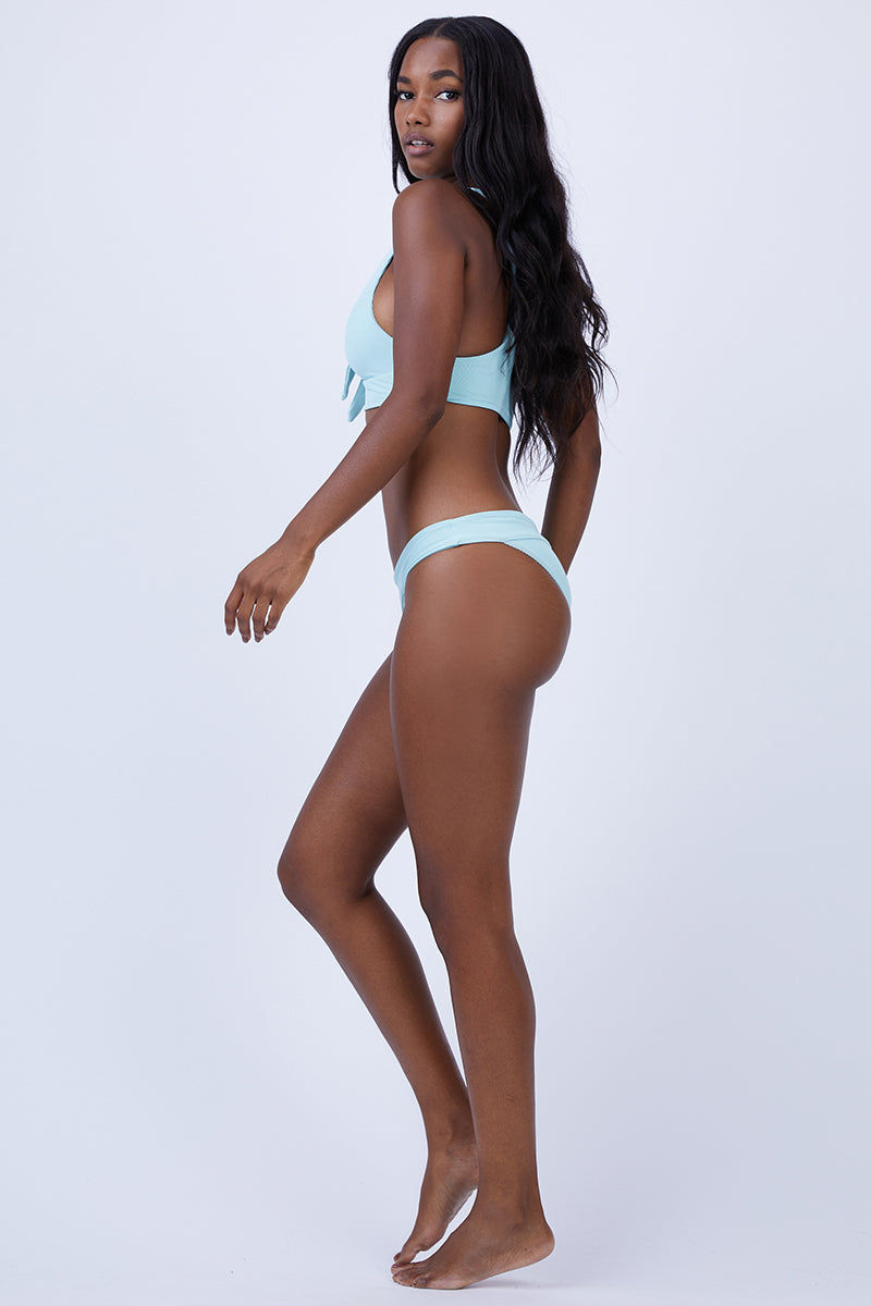 L SPACE Veronica Thick Band Bikini Bottom - Light Turquoise Bikini Bottom |  Light Turquoise| L Space Veronica Thick Band Bikini Bottom - Light Turquoise. Features: Thick band across waist that creates a fold-over look Ribbed texture fabric Classic/moderate coverage Front View
