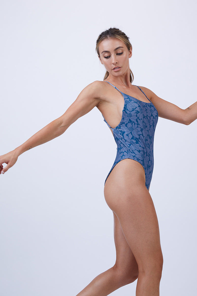 GILLIA Marina Criss Cross Back One Piece Swimsuit - Deep Ocean One Piece | Deep Ocean| GILLIA Marina Criss Cross Back One Piece Swimsuit - Deep Ocean One piece swimsuit Adjustable criss-cross High leg cut Moderate coverage 80% Nylon / 20% Spandex Made in Indonesia Side View