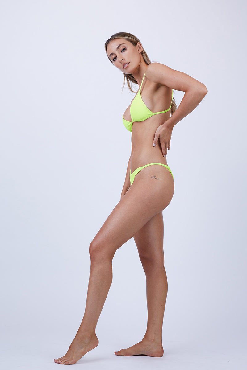 FRANKIES BIKINIS Willa String Side Bikini Bottom - Lemon Drop Yellow Bikini Bottom | Lemon Drop Yellow | Frankies Bikinis Willa String Side Bikini Bottom - Lemon Drop Yellow Features:  Thin Side Straps High Cut Leg Skimpy Coverage Ribbed Fabric Seamless Design 88% Nylon + 12% Spandex