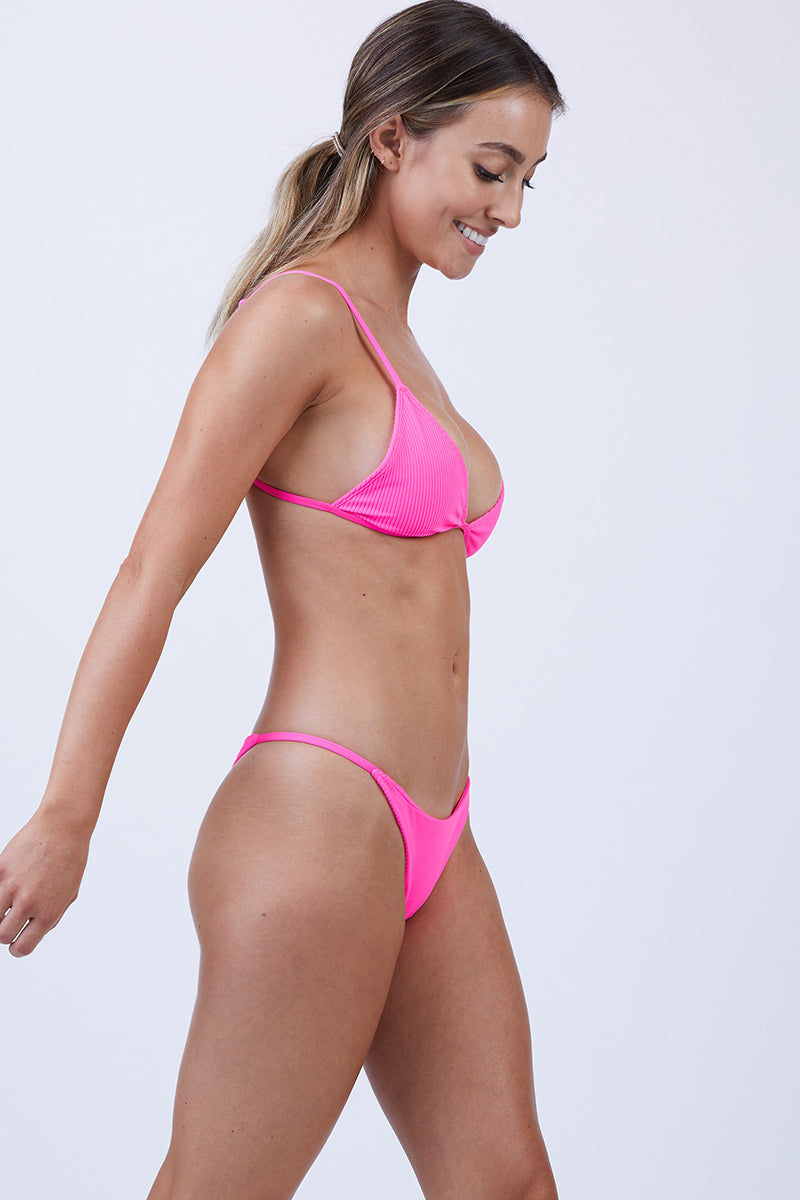 FRANKIES BIKINIS Chase Triangle Bikini Top - Heart Throb Pink Bikini Top   Heart Throb Pink  Frankies Bikinis Chase Triangle Bikini Top - Heart Throb Pink Features  Triangle Top Adjustable Straps Clasp BackClosure Luxe Ribbed Fabric 88% nylon 12% spandex Front View