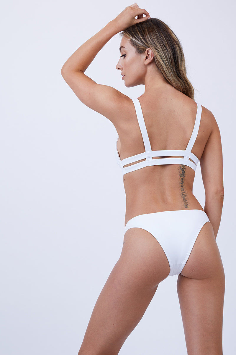 VITAMIN A Neutra Bralette Top - White Bikini Top | White| Vitamin A Neutra Bralette Top - White  Comfortable pullover Bralette-style bikini top Thick shoulder straps Double elastic underbust bands Double back straps Cut out at the center of the bust Diagonal seams on each bust cup Smooth, clean finish Back View