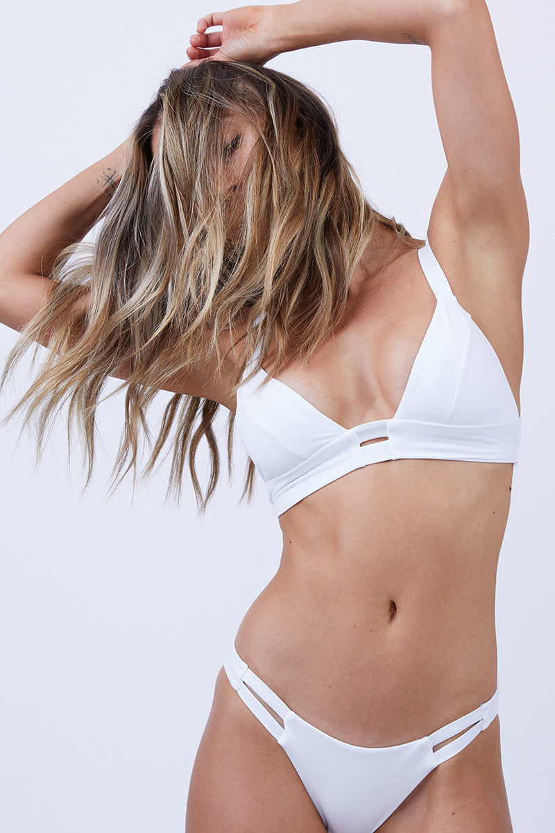 VITAMIN A Neutra Bralette Top - White Bikini Top | White| Vitamin A Neutra Bralette Top - White  Comfortable pullover Bralette-style bikini top Thick shoulder straps Double elastic underbust bands Double back straps Cut out at the center of the bust Diagonal seams on each bust cup Smooth, clean finish Front View