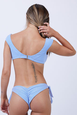 VITAMIN A Capri Top - Hamptons Stripe Bikini Top | Hamptons Stripe| Vitamin A Capri Top - Hamptons Stripe Off the shoulder cap sleeve top Clean front that can be worn on or off the shoulder Adjustable swan hook back closure MADE IN USA 61% Polyester + 33% Nylon + 6% Spandex Back View