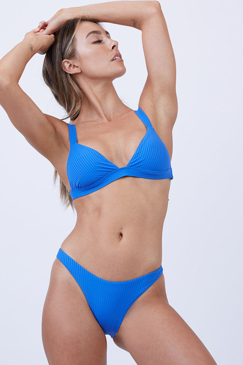 VITAMIN A Neutra Triangle Top - EcoRib Beach Blue Bikini Top | EcoRib Beach Blue| Vitamin A Neutra Triangle Top - Euro Rib Beach Blue  Comfortable pullover Triangle-style bikini top Thick shoulder straps Elastic underbust band Ribbed Fabric  Made in USA 84% Recycled Nylon + 16% Lycra Front View
