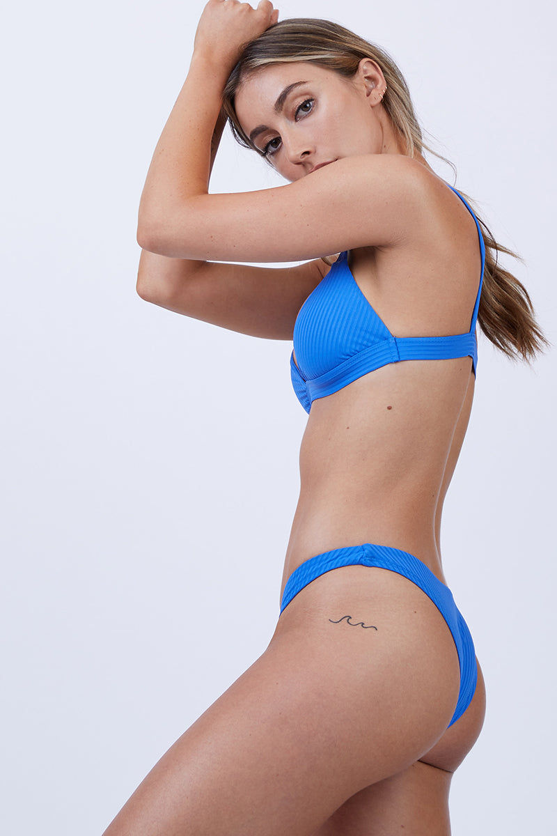 VITAMIN A Neutra Triangle Top - EcoRib Beach Blue Bikini Top | EcoRib Beach Blue| Vitamin A Neutra Triangle Top - Euro Rib Beach Blue  Comfortable pullover Triangle-style bikini top Thick shoulder straps Elastic underbust band Ribbed Fabric  Made in USA 84% Recycled Nylon + 16% Lycra Side View