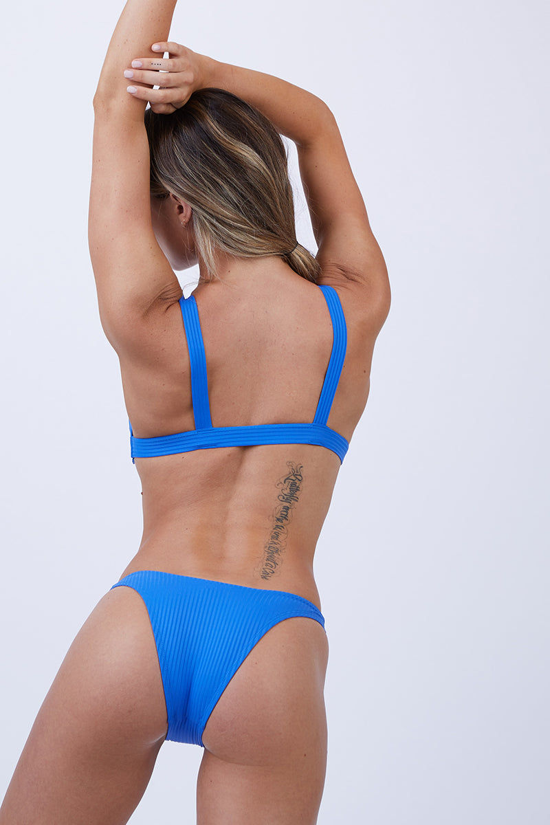 VITAMIN A Neutra Triangle Top - EcoRib Beach Blue Bikini Top | EcoRib Beach Blue| Vitamin A Neutra Triangle Top - Euro Rib Beach Blue  Comfortable pullover Triangle-style bikini top Thick shoulder straps Elastic underbust band Ribbed Fabric  Made in USA 84% Recycled Nylon + 16% Lycra Back View