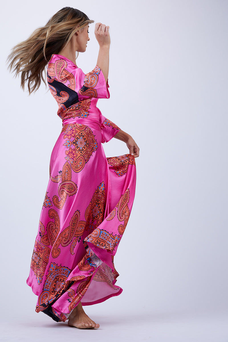 LENNI Witching Adjustable Wrap Top - Scarf Top | Scarf| Lenni Witching Wrap Adjustable Top - Scarf. Side View. Features: The witching top in pink scarf was made to be noticed. In a classic wrap style, versatile and adjustable. Cross it over and through the keyhole to tie at the back for a more covered look, or tie it at the front keeping it sexy but sweet. Featuring 3/4 bell sleeves and a cropped fit, ready for those balmy nights.