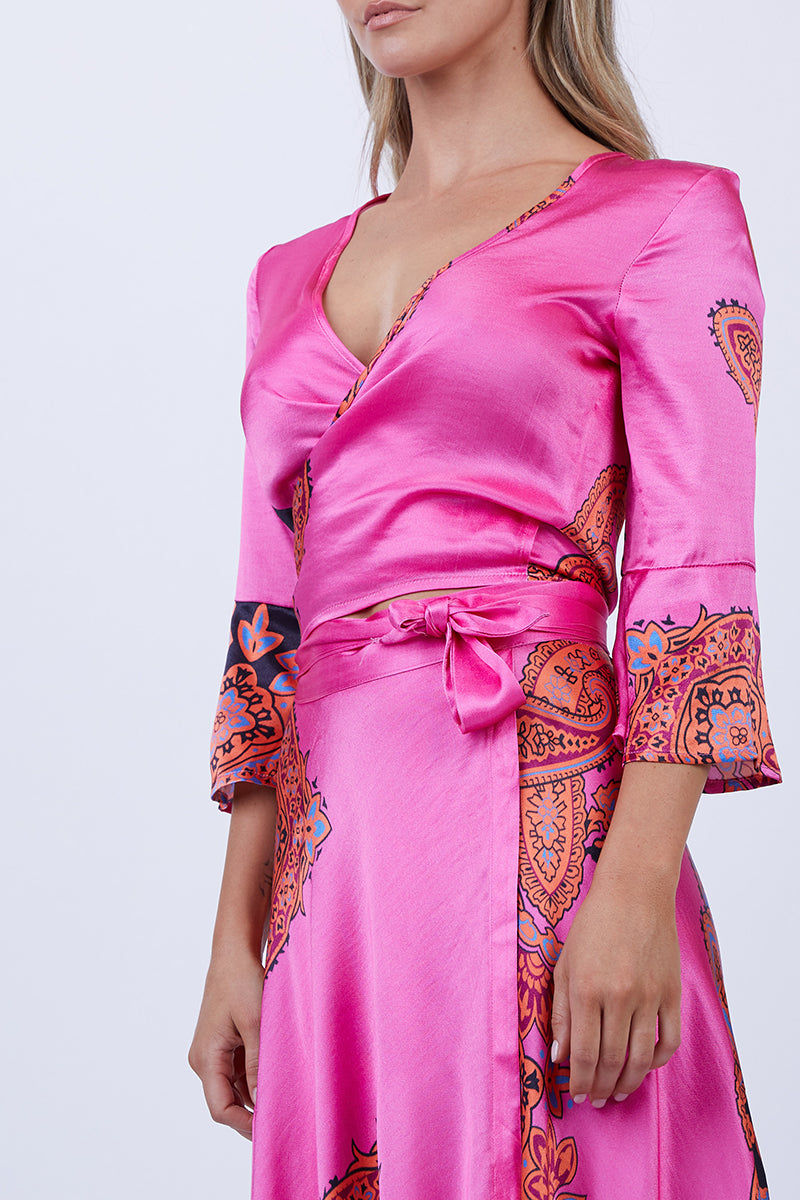 LENNI Witching Adjustable Wrap Top - Scarf Top | Scarf| Lenni Witching Wrap Adjustable Top - Scarf. Close Up View. Features: The witching top in pink scarf was made to be noticed. In a classic wrap style, versatile and adjustable. Cross it over and through the keyhole to tie at the back for a more covered look, or tie it at the front keeping it sexy but sweet. Featuring 3/4 bell sleeves and a cropped fit, ready for those balmy nights.