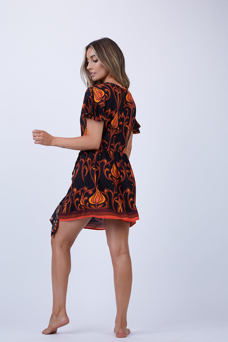 LENNI Sugar Ruffle Mini Dress - Deco Floral Black Dress   Deco Floral Black  Lenni Sugar Ruffle Mini Dress - Deco Floral Black. Back View. Features:  Scoop neckline. Ruffle sleeves. Gathered mini skirt with vertical ruffle feature. Hand stitched detail throughout.
