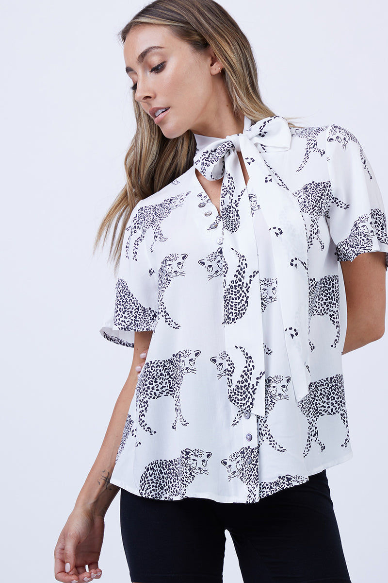 LENNI Mars Short Sleeve Blouse - Monocat Top | Monocat| Lenni Mars Short Sleeve Blouse - Monocat. Front View. Features:  Short sleeve button down front Pussy bow neck Content:  Made from 100% hand-drawn and printed rayon fabric