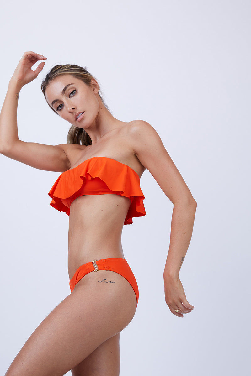 L SPACE Rosemary Hipster Bikini Bottom - Poppy Bikini Bottom | Poppy| L Space Rosemary Hipster Bikini Bottom - Poppy. Gold hardware at hip points Available in bitsy and full coverage Side View