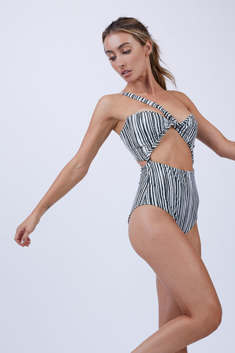 GILLIA Bruna One Shoulder One Piece Swimsuit - Monochrome One Piece | Monochrome| GILLIA Bruna One Shoulder One Piece Swimsuit - Monochrome One shoulder strap detail Front cutout Back tie detail High waist bottom Moderate coverage 80% Nylon / 20% Spandex Made in Indonesia Side View