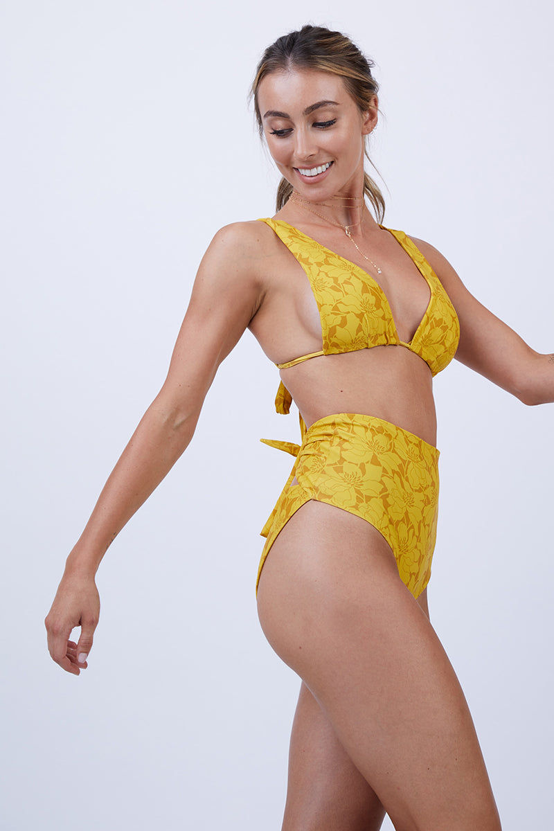 GILLIA Clara Long Triangle Bikini Top - Marigold Bikini Top | Marigold| GILLIA Clara Long Triangle Bikini Top - Marigold Long triangle top Thick shoulder straps for extra support Back tie closure 80% Nylon / 20% Spandex Made in Indonesia Side View