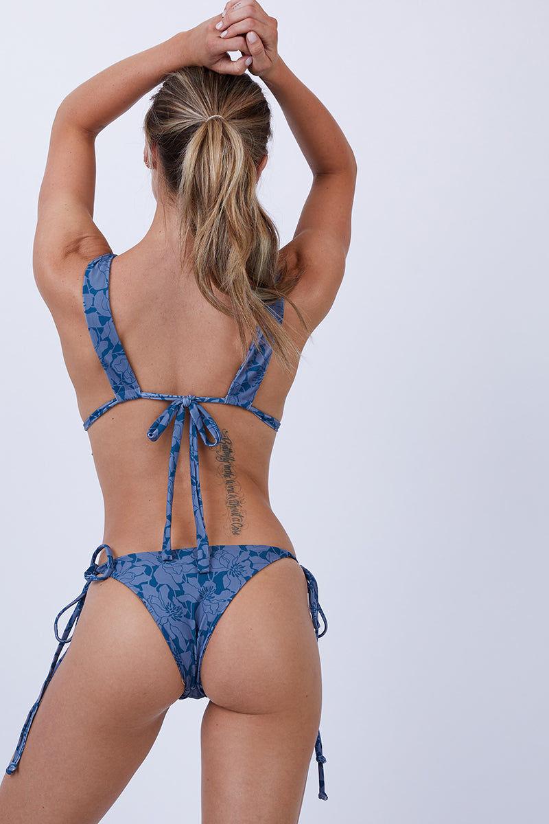 GILLIA Kapalua Tie Side Bikini Bottom - Deep Ocean Bikini Bottom | Deep Ocean| GILLIA Kapalua Tie Side Bikini Bottom - Deep Ocean Tie side detail Thin straps Skimpy coverage 80% Nylon / 20% Spandex Made in Indonesia Back View