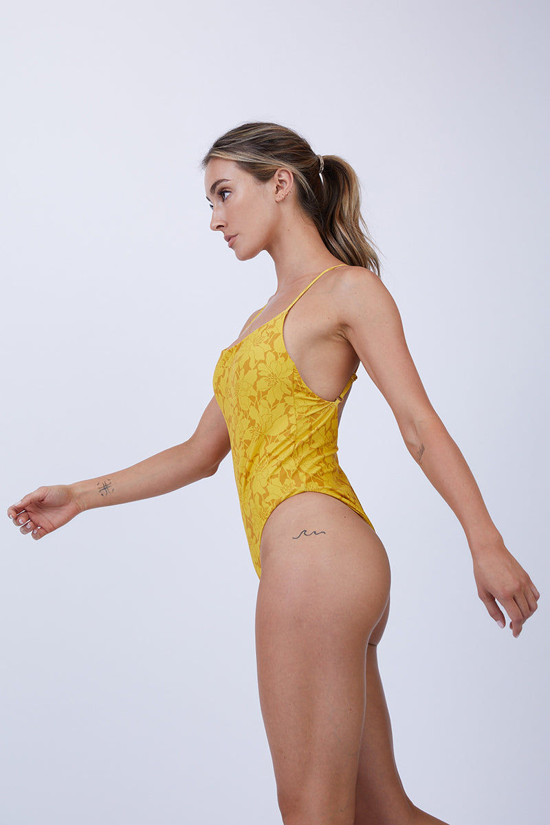 GILLIA Marina Criss Cross Back One Piece Swimsuit - Marigold One Piece   Marigold  GILLIA Marina Criss Cross Back One Piece Swimsuit - Marigold One piece swimsuit Adjustable criss-cross High leg cut Moderate coverage 80% Nylon / 20% Spandex Made in Indonesia Side View