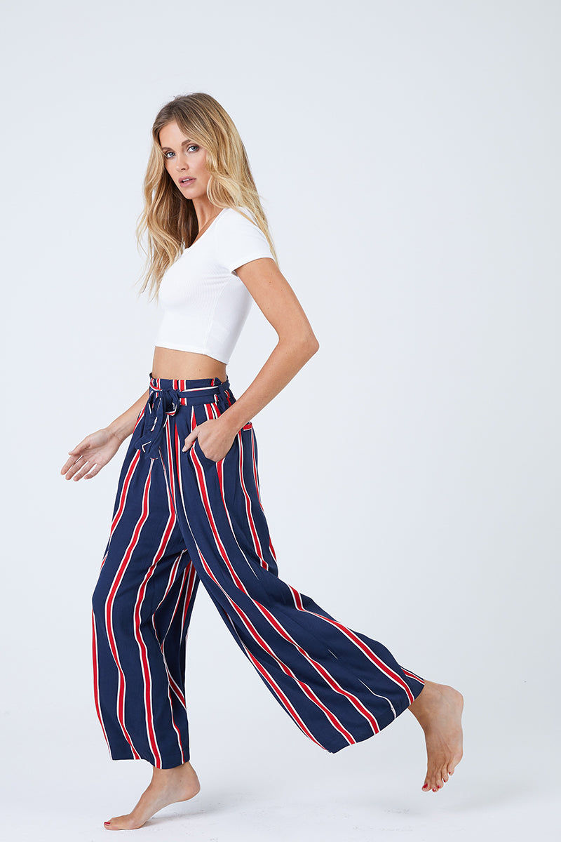MINKPINK Nautica Cropped Trousers - Navy & Red Stripes Pants | Navy & Red Stripes| MinkPink Nautica Cropped Trousers - Navy & Red Stripes. Features:  High waisted with tie belt Relaxed fit Cropped length Fully lined 100% Viscose Front View