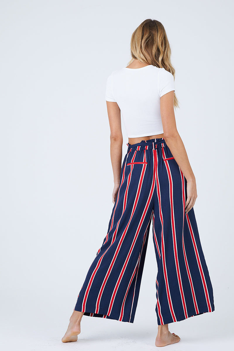 MINKPINK Nautica Cropped Trousers - Navy & Red Stripes Pants | Navy & Red Stripes| MinkPink Nautica Cropped Trousers - Navy & Red Stripes. Features:  High waisted with tie belt Relaxed fit Cropped length Fully lined 100% Viscose Back View