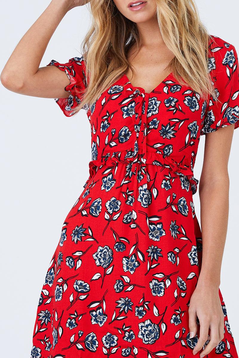MINKPINK Terrace Short Sleeve Dress - Red Floral Dress | Red Floral| MinkPink Terrace Short Sleeve Dress - Red Floral Short Sleeve Dress V Neckline Ruched Bust With Tie Detail Ruffle Detail Hidden Side Zipper Closure Self & Lining: 100% Viscose Close View