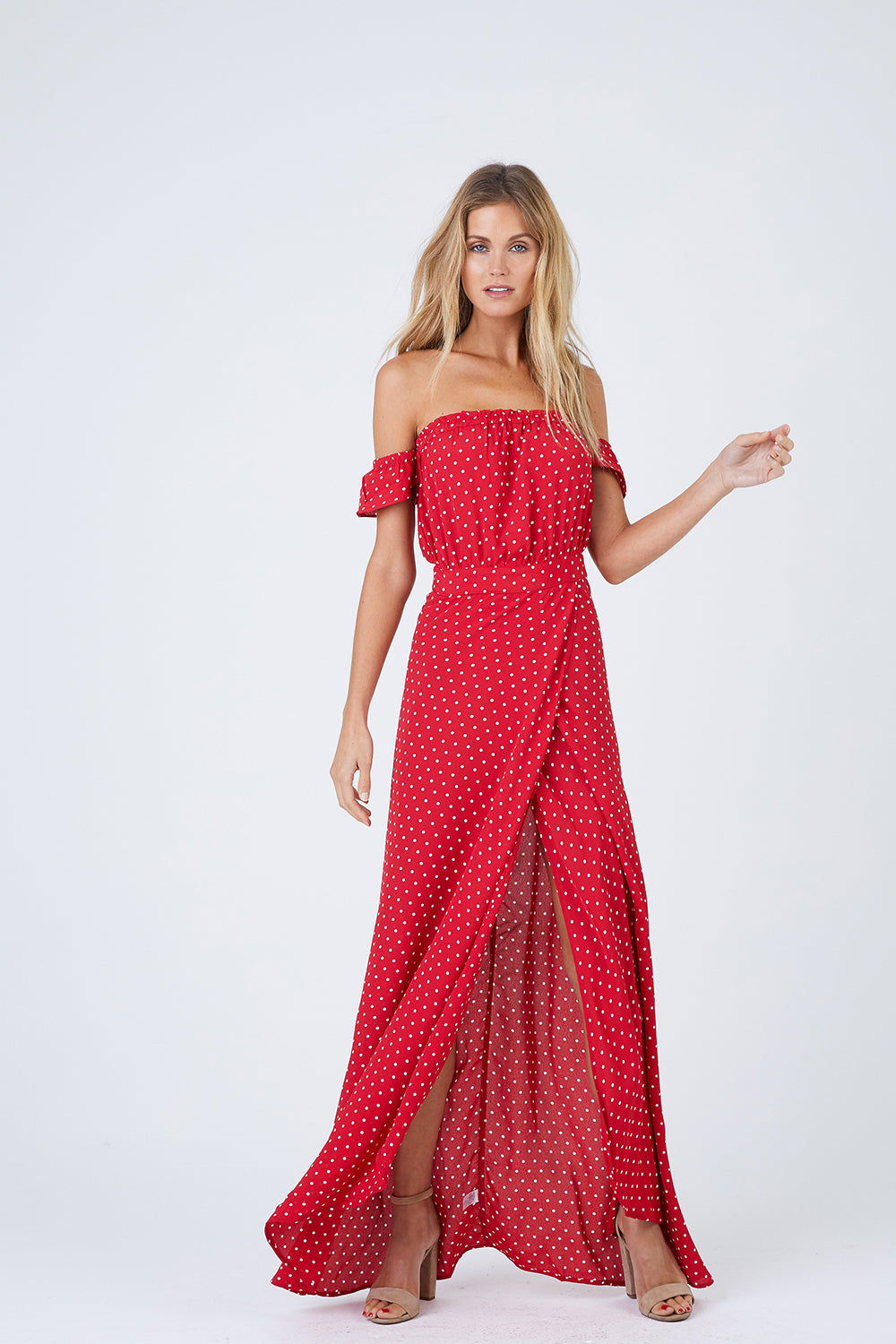 FLYNN SKYE Bella Off The Shoulder Maxi Dress - Cherry Dots Dress | Cherry Dots| Flynn Skye Bella Maxi Dress - Cherry Dots Ruffled off shoulder straps Dramatic wrap skirt High, ultra-sexy leg slit at the front Stretchy gathered elastic band at the back 100% Rayon Dry clean Made in Los Angeles Front View