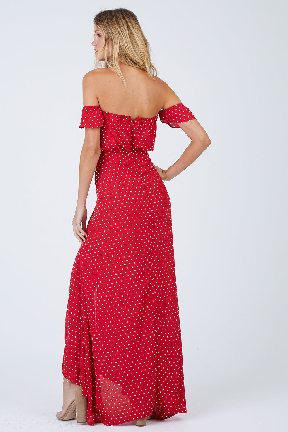 FLYNN SKYE Bella Off The Shoulder Maxi Dress - Cherry Dots Dress | Cherry Dots| Flynn Skye Bella Maxi Dress - Cherry Dots Ruffled off shoulder straps Dramatic wrap skirt High, ultra-sexy leg slit at the front Stretchy gathered elastic band at the back 100% Rayon Dry clean Made in Los Angeles Back View