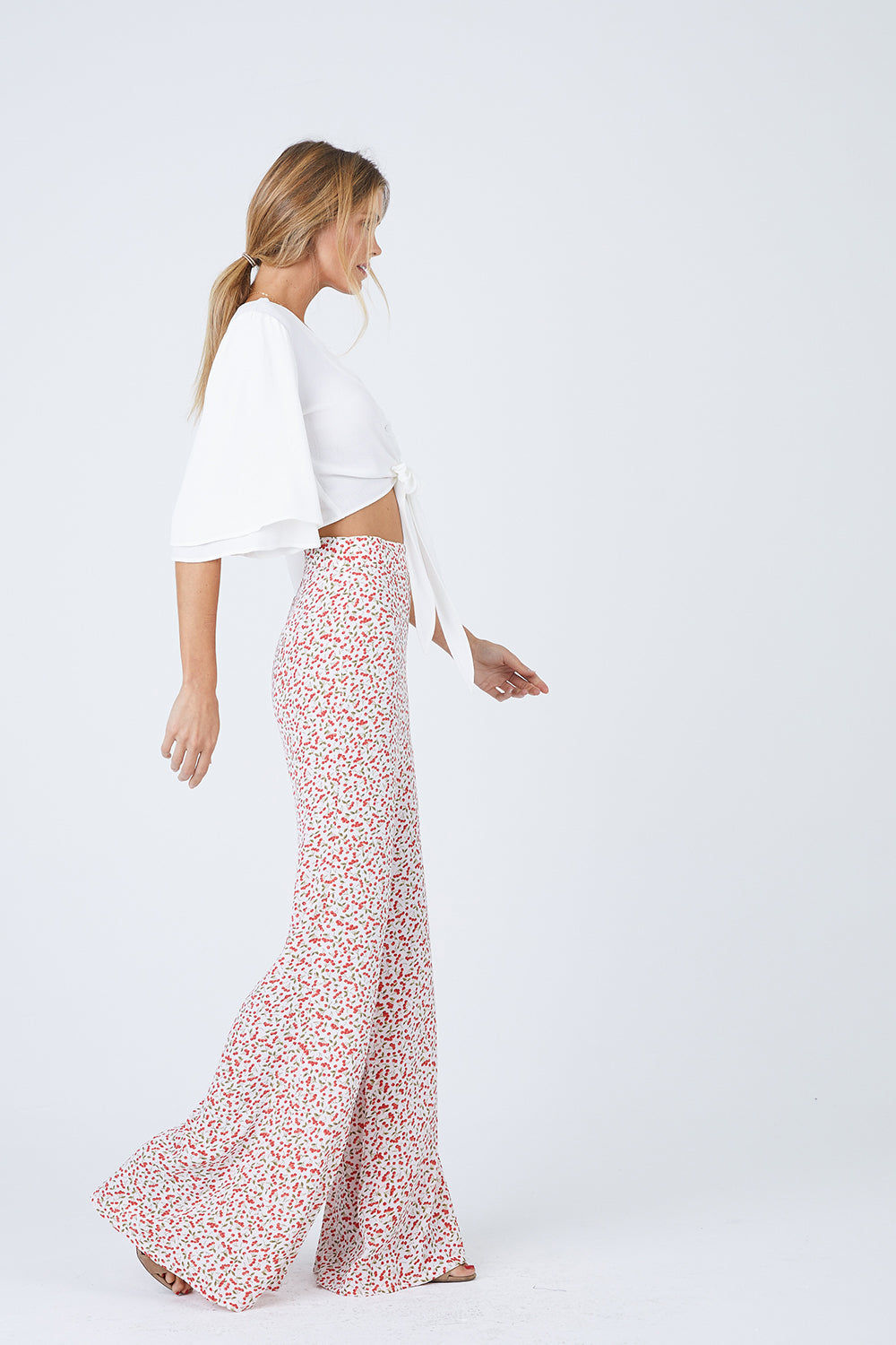 FLYNN SKYE Lilly Front Tie Top - White Top | White| Flynn Skye Lilly Front Tie Top - White  Relaxed fit white crop top with button and tie front closure. 3/4 length kimono sleeves  Extra long adjustable knot tie closure Front View