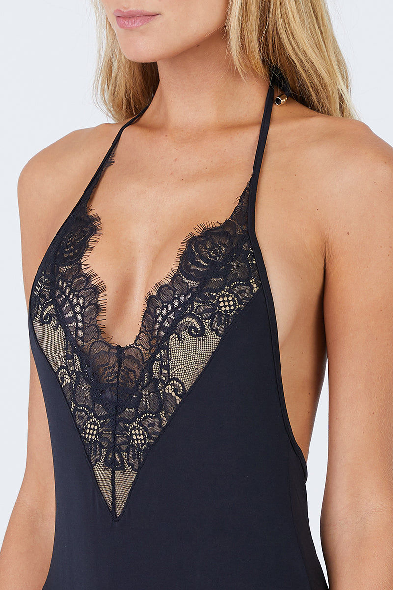 BEACH BUNNY Farrah Plunging Lace One Piece Swimsuit - Black One Piece | Black| Beach Bunny Farrah Plunging Lace One Piece Swimsuit - Black V Neckline  Delicate Lace Detail Adjustable Halter Neck Tie  Back Tie Closure High Cut Leg  Cheeky Coverage Front View