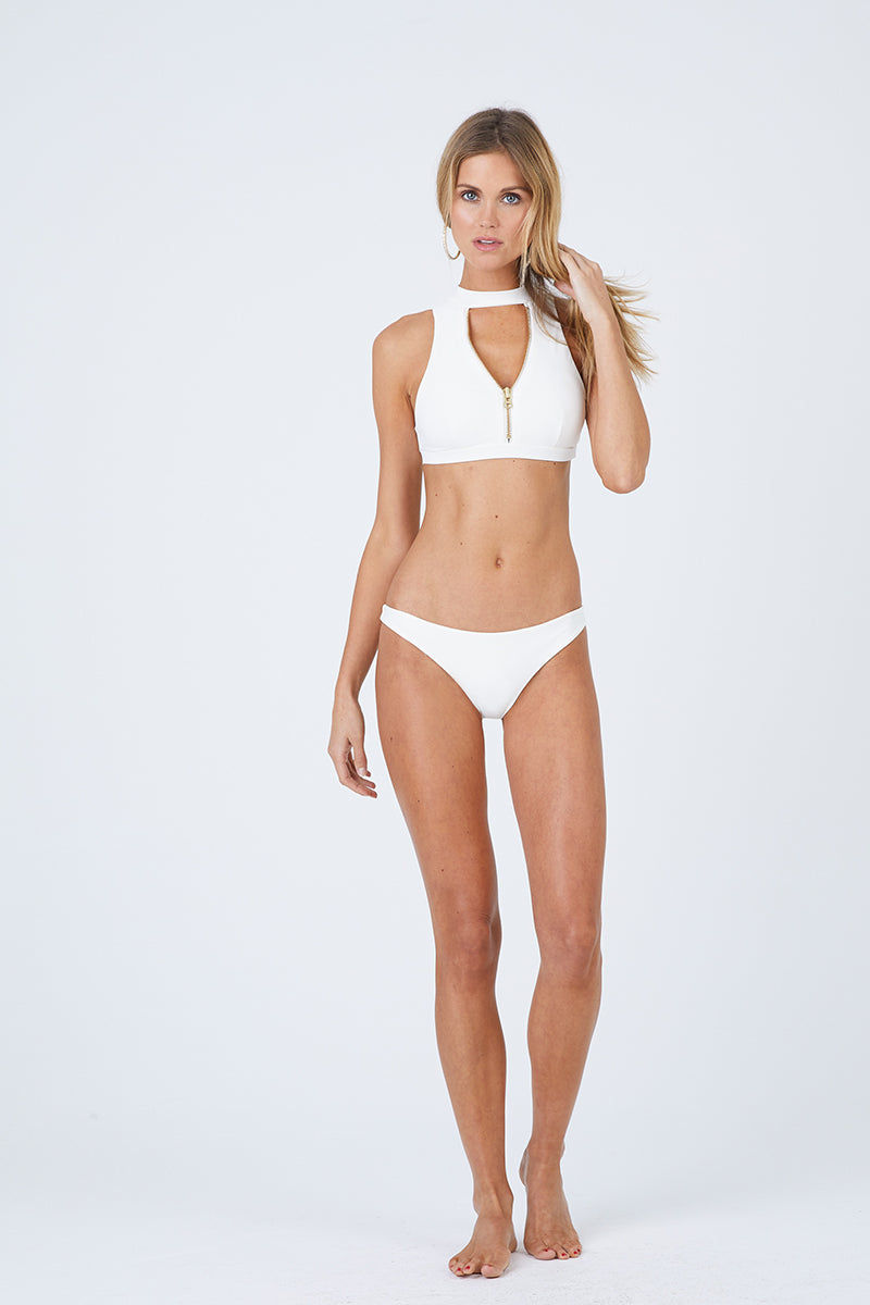 BEACH BUNNY Zoey High Neck Zipper Front Bikini Top - Ivory White Bikini Top | Ivory White| Beach Bunny Zoey High Neck Zipper Front Bikini Top - Ivory White Zip up front detail Plunging  v-neck Choker detail with hook closure Open back cut out  Front View