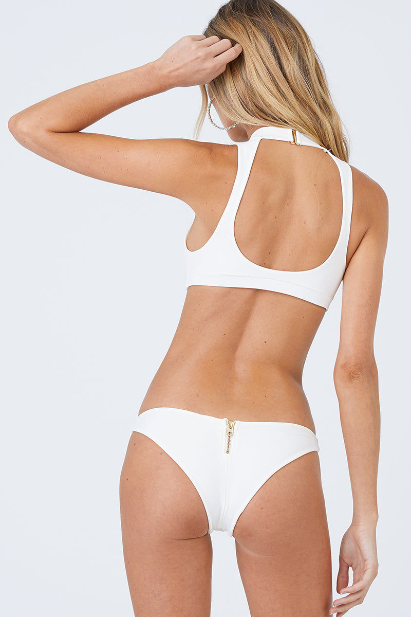 BEACH BUNNY Zoey High Neck Zipper Front Bikini Top - Ivory White Bikini Top | Ivory White| Beach Bunny Zoey High Neck Zipper Front Bikini Top - Ivory White Zip up front detail Plunging  v-neck Choker detail with hook closure Open back cut out  Back View