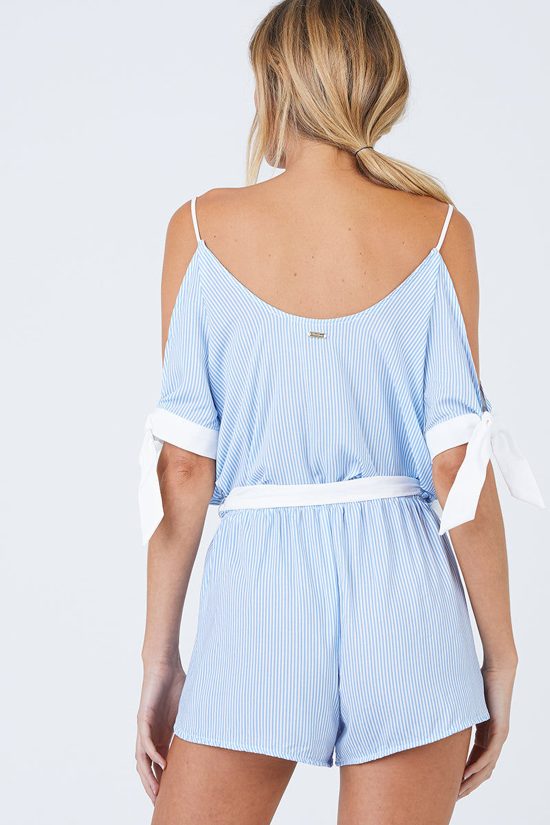 BEACH BUNNY Lola Off The Shoulder Romper - Riviera Blue Stripe Print Dress | Riviera Blue Stripe Print| Beach Bunny Lola Off The Shoulder Romper - Riviera Blue Stripe Print  Deep V Neckline  Cut Out At Arms With Tied Cuffs Adjustable Shoulder Straps  Drop Waist With Sash Tie Belt Back View