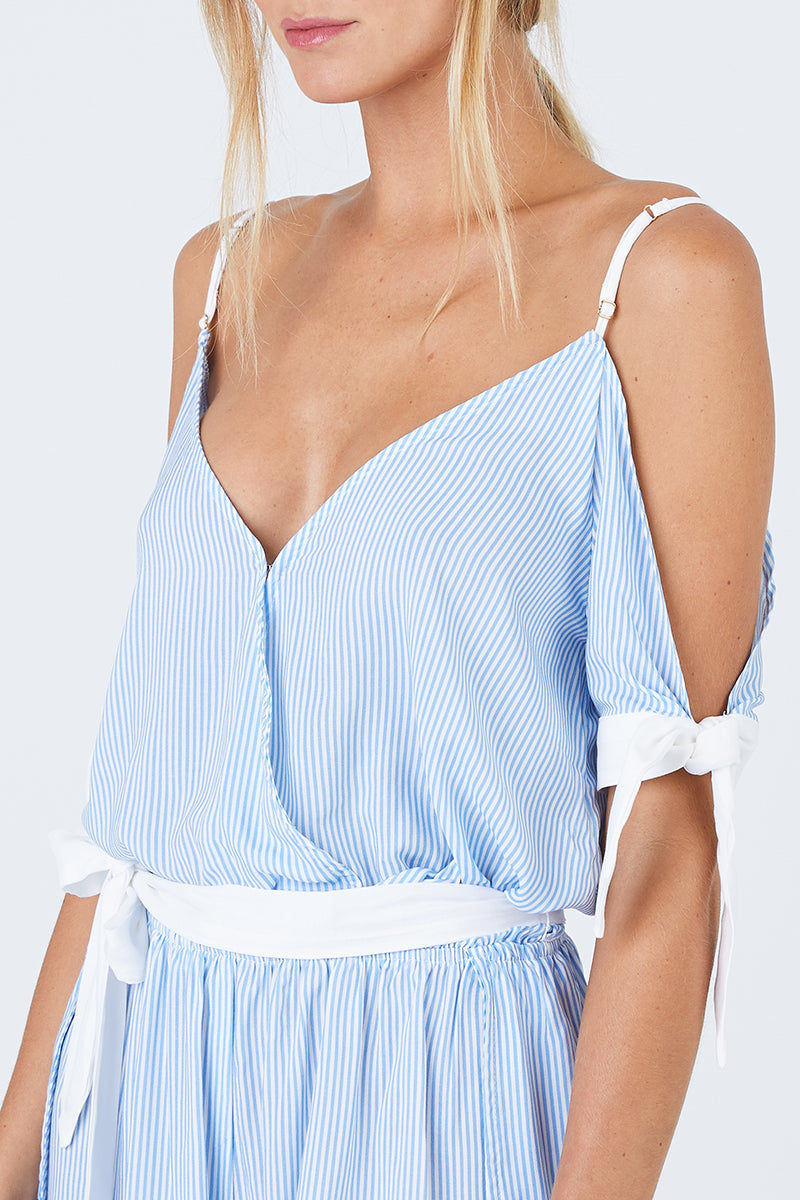 BEACH BUNNY Lola Off The Shoulder Romper - Riviera Blue Stripe Print Dress | Riviera Blue Stripe Print| Beach Bunny Lola Off The Shoulder Romper - Riviera Blue Stripe Print  Deep V Neckline  Cut Out At Arms With Tied Cuffs Adjustable Shoulder Straps  Drop Waist With Sash Tie Belt Front View