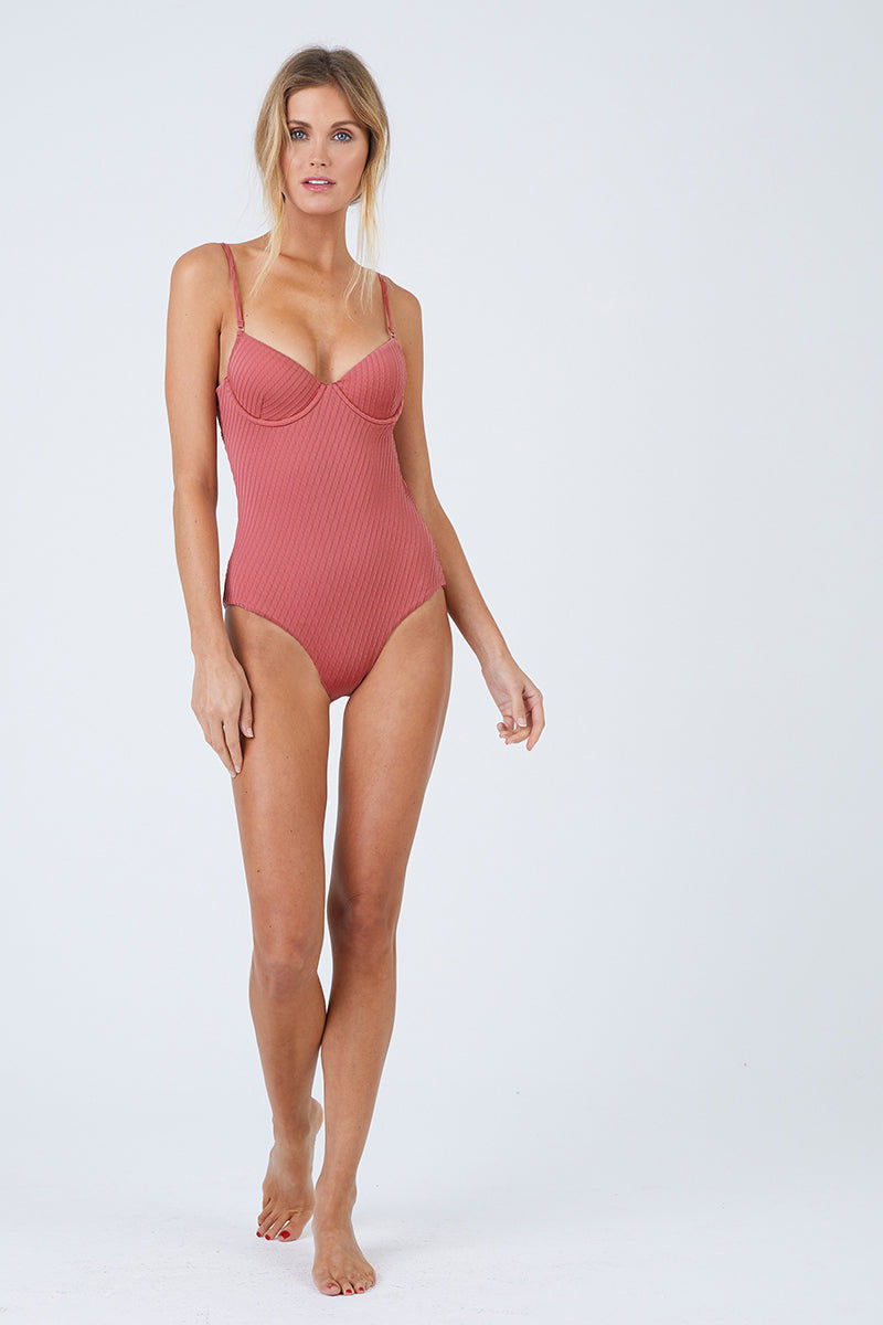FELLA Sebastian One Piece - Spice One Piece | Spice| Sebastian One Piece Front View Features:  Italian Textured Lycra Plunging underwired neckline with thin adjustable straps Perfect to wear from day to night as a bodysuit under shorts or a skirt Cheeky bum Fits true to size