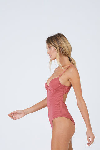 FELLA Sebastian Underwire One Piece Swimsuit - Spice One Piece | Spice| Sebastian One Piece Front View Features:  Italian Textured Lycra Plunging underwired neckline with thin adjustable straps Perfect to wear from day to night as a bodysuit under shorts or a skirt Cheeky bum Fits true to size