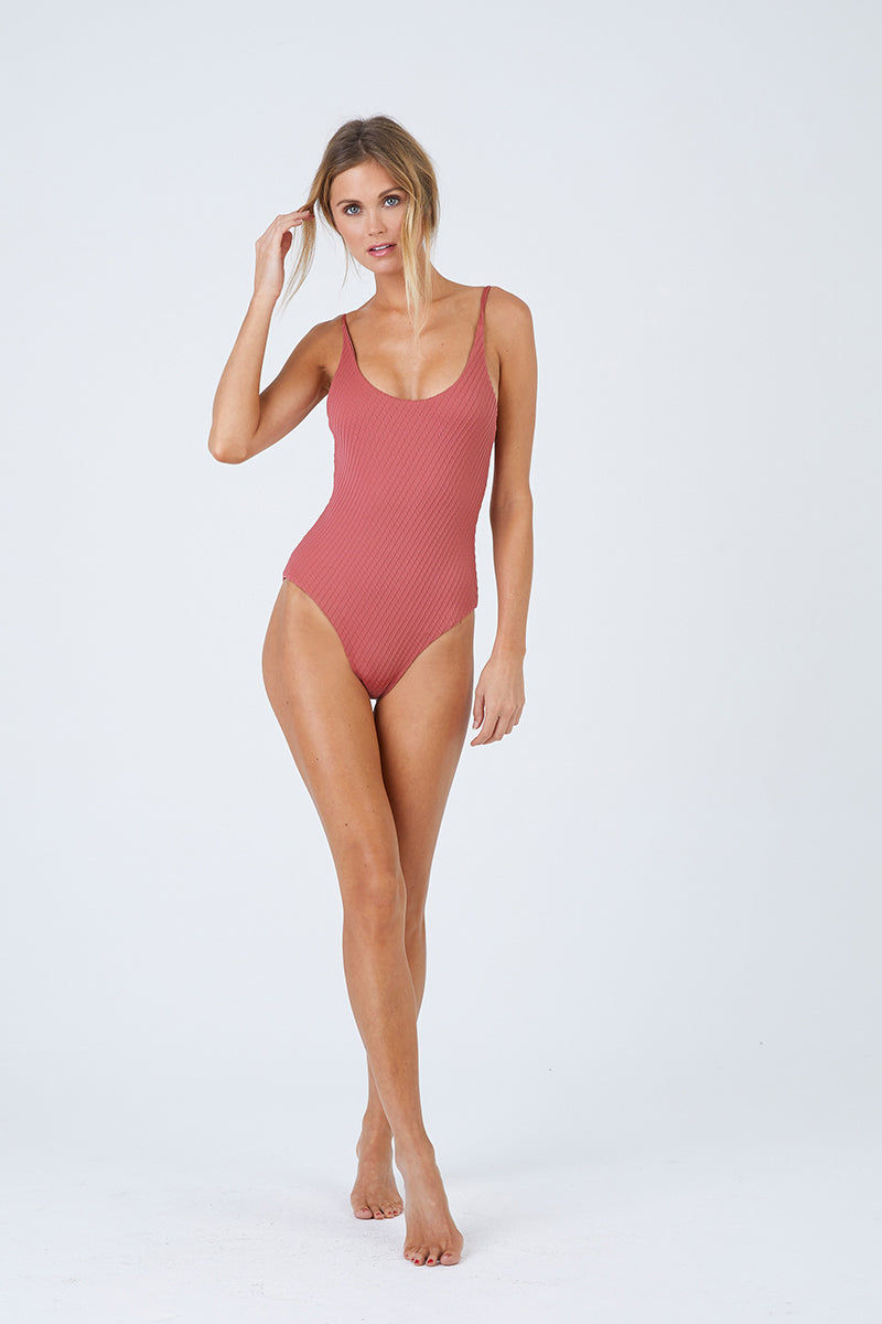 FELLA Zac Strappy Back One Piece Swimsuit - Spice One Piece | Spice|Zac One Piece Features:  Italian Textured Lycra Round neckline with thin straps that cross over at the back Perfect to wear from day to night as a bodysuit under shorts or a skirt Cheeky bum Fits true to size