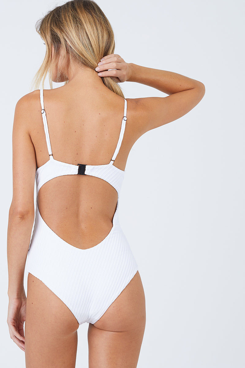 FELLA Sebastian One Piece - White One Piece   White Sebastian One Piece Front View Features:  Italian Textured Lycra Plunging triangle neckline with thin adjustable straps Underwired support Perfect to wear from day to night as a bodysuit under shorts or a skirt Cheeky bum Fits true to size