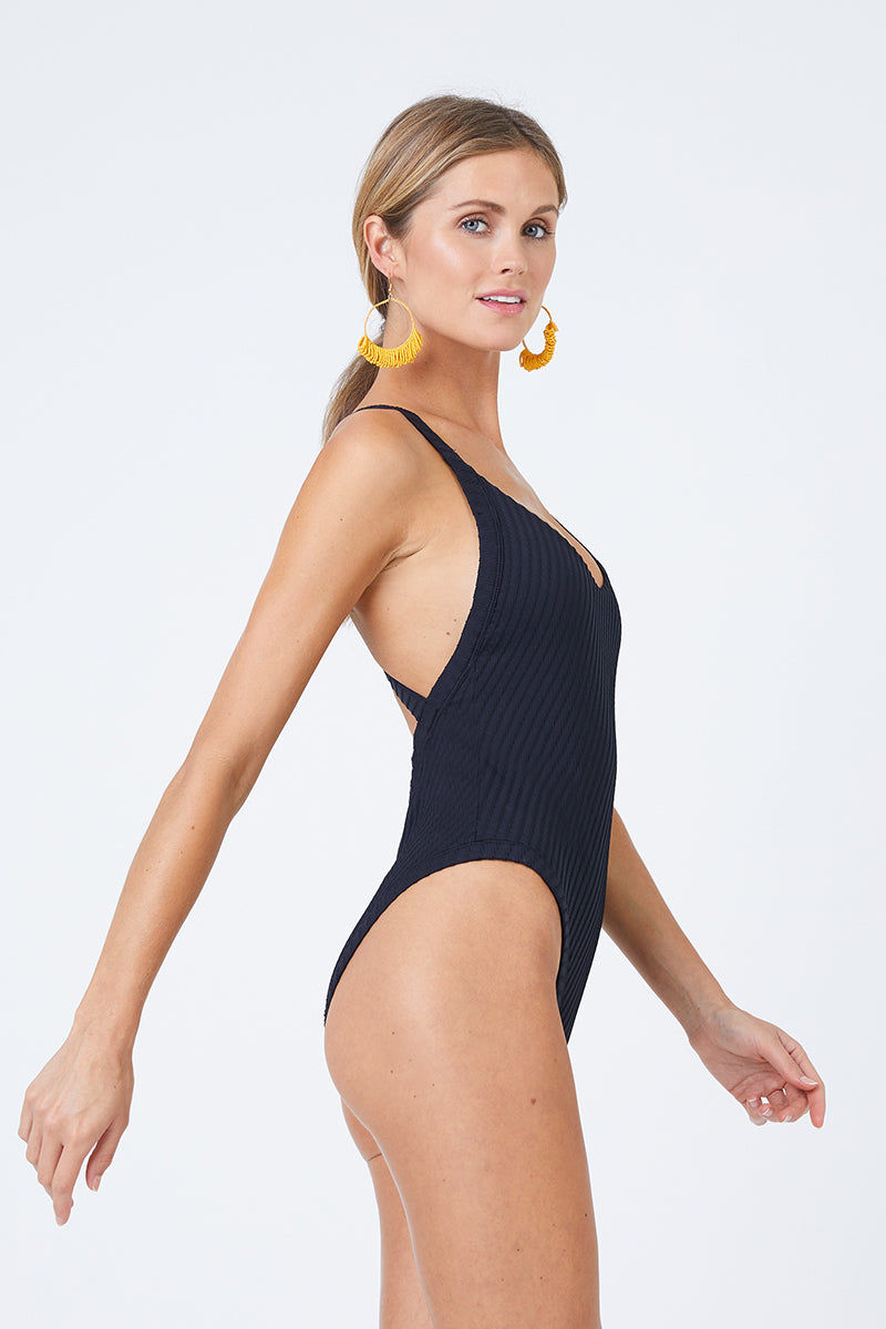 FELLA Archie Scoop Neck One Piece Swimsuit - Black One Piece | Black| Fella Archie Scoop Neck One Piece Swimsuit - Black. Features: Sleek black scoop neck one piece swimsuit in on-trend textured finish. Stretchy fixed straps criss-cross deep open back for a sexy look that offers subtle support. High-quality Italian Lycra fabric with on-trend texturing adds dimension to the one piece swimsuit. View:  Close up side view