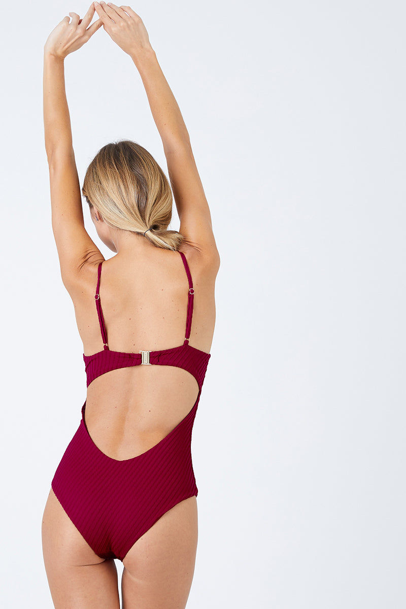 FELLA Sebastian Underwire One Piece Swimsuit - Magenta One Piece | Magenta|Sebastian One Piece Features:  Italian Textured Lycra Plunging underwired neckline with thin adjustable straps Perfect to wear from day to night as a bodysuit under shorts or a skirt Cheeky bum Fits true to size